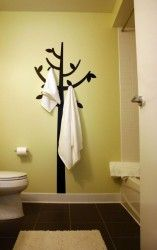 Paint the tree on the wall then add hooks for towel/robe storage…. so useful and neat looking ! You might also like: