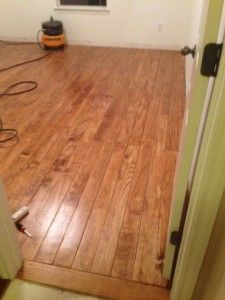 """Plywood floor for my boys room- like a captains deck? this is 1/2 in plywood cut into 4"""" strips and installed with nails, stain, and poly."""