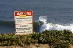 """Santa Cruz, California. This sign reminded me of the story of the cliff-  A man fell off a cliff, but managed to grab a tree limb on the way down. The following conversation ensued: """"Is anyone up there?""""  """"I am here. I am the Lord. Do you believe me?"""" """"Yes, Lord, I believe. I really believe, but I can't hang on much longer."""" """"That's all right, if you really believe you have nothing to worry about. I will save you. Just let go of the branch."""" A moment of pause, then: """"Is anyone else up…"""