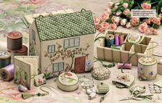 Discover the hidden secrets of this exquisite embroidered workbox.  'Home Sweet Home' by Carolyn Pearce is an international needlework phenomenon that has captured the imagination of stitchers the word over.  This charming English cottage, beautifully decorated with a garden of stitches, opens to reveal 9 gorgeous accessories and includes storage for all your notions.  Pages of glorious colour photography and detailed instructions make this an irresistible book you'll treasure for a…