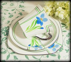 Art Deco Springtime Trio, Handpainted Roslyn Silver Lustre Blue Iris Apple Green Cup Saucer Teaplate 1940s, via Etsy.