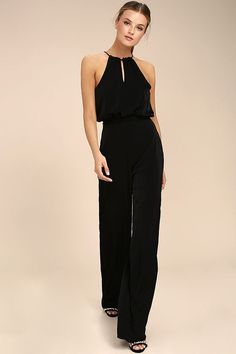 Lulus Exclusive! The Dance With You Black Jumpsuit will have you groovin' all night long! Silky soft woven poly shapes a halter neckline, with front and back keyhole cutouts, fitted waist, and long, relaxed pants. Tying sash belt. Hidden back zipper.