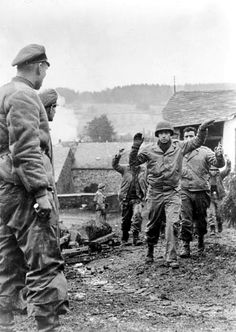 ■ American soldiers of the 119th Infantry Regiment's 3rd Battalion are taken prisoner by German soldiers of Kampfgruppe Peiper during the Battle of the Bulge. Stoumont, Liège, Belgium. 19 December 1944.