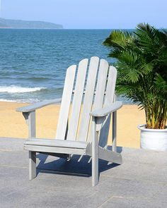 Nothing says summer better than the laid-back, casual feel of the Safavieh Topher Eucalyptus Adirondack Chair . This classic Adirondack chair is. Teak Adirondack Chairs, Outdoor Chairs, Outdoor Decor, Patio Chairs, Indoor Outdoor, Outdoor Furniture, Brown Armchair, Grey Chair, Back Patio