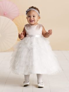Joan Calabrese for Mon Cheri - 110306B - Sleeveless satin, tulle and organza tea-length A-line fancy baby dress with satin ribbon tie at natural waist, multi-tiered and ruffled tulle full skirt.Also available in sizes 2 - 16 as 110306 in Champagne/Ivory, Ivory/Blush, Ivory and White.Sizes:�6 mos. - 24 mos.Colors: Champagne/Ivory, Ivory/Blush, Pink/Ivory, White, Ivory