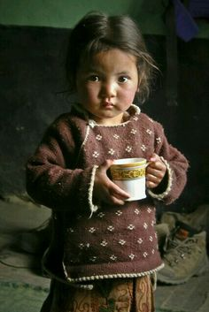 Child drinking soup.