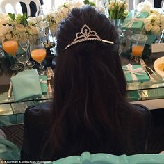Princess for a day: Kourtney wears her Breakfast At Tiffany's tiara during her baby shower...