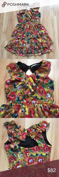 Rachel Roy Dress Size 6. Colorful flowy summer dress full of ruffles. High V neck with a keyhole cutout in back (button closure at very top of back piece hidden in the ruffles). Zipper in back. Chest 17in. Waist (just above skirt ruffle) 14. Length about 32-33in. 100% polyester. Fully lined inside. Not much stretch to the dress so please verify measurements to ensure fit. RACHEL Rachel Roy Dresses Mini