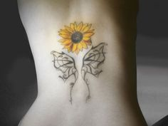 Minimalist sunflower tattoo design. The sunflower is seen to be flying above a set of lacelike frames forming butterfly wings.
