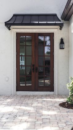 Heights House Patio & Awning Juliet metal awning + new patio details (custom ordered from Design Your Awning). Front Door Awning, Front Door Canopy, Porch Awning, Metal Door Awning, Metal Door Canopy, Metal Awnings For Windows, Farmhouse Design, Farmhouse Decor, Farmhouse Style