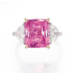 PLATINUM, 18 KARAT GOLD, PINK SAPPHIRE AND DIAMOND RING Centered by a cushion-cut pink sapphire weighing approximately 6.10 carats, flanked by two half-moon-shaped diamonds weighing approximately 1.95 carats