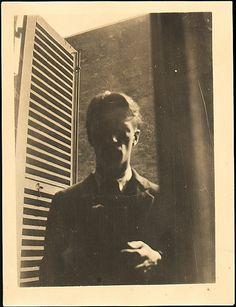 Self-portrait in Window, 5 rue de la Santé, Paris. Walker Evans