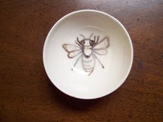 Fun in the kitcken.    little busy bee bowl. $8.50, via Etsy.