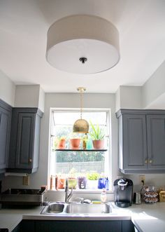 New to our kitchen: An oil-rubbed bronze and drum shade semi-flush mount fixture from Lowe's, and a hammered brass pendant from Shades of Light. | Glitter and Goat Cheese