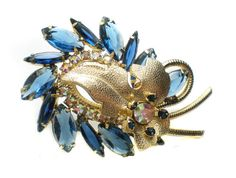 Juliana Verified D&E Bright Blue Leaf Spiral Rhinestone Brooch with Navette Stones and Aurora Borealis on Gold Tone - Vintage Jewelry