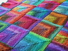 I don't knit but I would love to have this in my house somewhere! Mitered blocks done with a painted yarn, such as Noro.