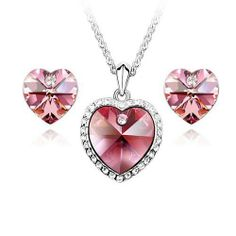 """Blue Chip Unlimited - Elegant Crystal Heart Pendant in Rose Pink with 18k White Rolled Gold Plate 18"""" Chain and Matching Earrings Fashion Jewelry Pendant Necklace Stud Earrings Blue Chip Unlimited. $39.95. Perfect gift for every occasion!. Brand New Item!. Please Note: For Pierced Ears Only. Matching Necklace & Earring Set. Rose Pink Heart Crystal Pendant Necklace & Earrings Set. Save 60% Off!"""