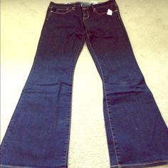 NWT dark rinse flared jeans! NWT and never worn. This trend is in this summer with the 70s vintage feel! Slim fit up top with flared legs. 32 in inseam. Curvy fit by gap. Good for gals with small waits and a bit of curve in hips. GAP Jeans Flare & Wide Leg