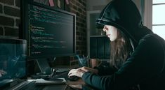 young professional female hacker using keyboard typing bad data into computer online system and spreading to global stolen personal information.
