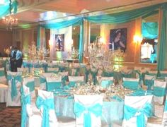 The use of teal on the walls helps balance symmetry in the color palette.