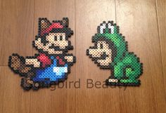 Hey, I found this really awesome Etsy listing at https://www.etsy.com/listing/184178527/tanooki-mario-and-frog-luigi-perler