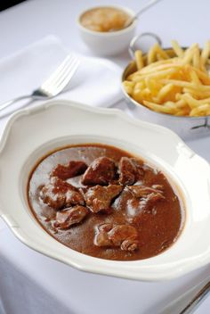 Belgian beef and beer stew (stoofvlees) Dutch Recipes, Cooking Recipes, Healthy Recipes, Belgium Food, Dutch Kitchen, Cooking With Beer, Good Food, Yummy Food, Dinner Side Dishes