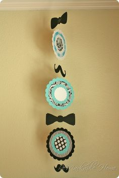 hanging mobile from little man shower
