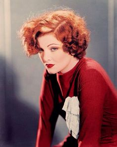 Myrna Loy. Red hair. Makeup. Fashion.