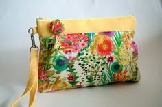 Zipped wristlet with London Liberty fabric!  This wristlet is a perfect size for holding your ID, money, cosmetics, cellar phone, accessories etc.