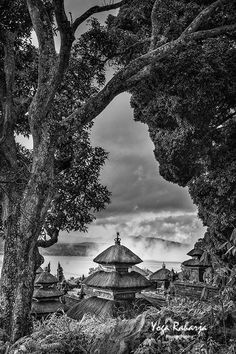 POSTCARD FROM BALI - Trunyan, Bali A photograph taken in a village called Trunyan, near lake Batur. From Kintamani, we could take a boat for about 15 minutes to go to this village. An interesting village to visit when you are in Bali. The building (like a pagoda) is a balinese hindhu temple which is located not far from the lake Batur.