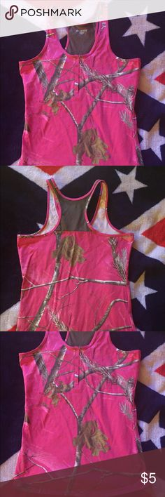 Mossy Oak Pink Razorback Tank-top Button that can be undone in the front, mesh on the backside of the straps. Perfect for anyone who loves Pink Camouflage and wants to wear it outside of hunting season!! Mossy Oak Tops Tank Tops