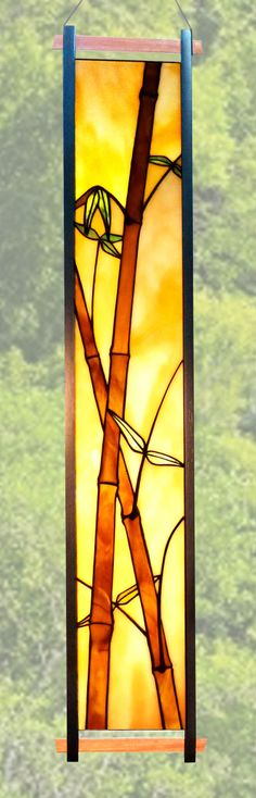 "A bamboo design window hanging, in a frame of African Mahogany.  It is about 42"" high."