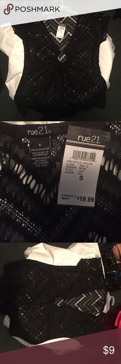 Brand new (with tags) black dressy lace top. This is from Rue 21. Size small, 100% polyester. It's black and kind of has a lace look to it. It's very pretty. It would be cute with jeans or a skirt. I bought it & never wore it. It still has tags attached. Rue 21 Tops Blouses