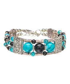 Look what I found on #zulily! Turquoise & Black Feather Bracelet #zulilyfinds