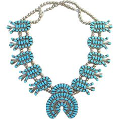 This is a Vintage Zuni Petit Point Turquoise Sterling Silver Squash Blossom Necklace Native American Southwestern. This spectacular turquoise squash