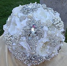 White brooch bouquet. Like the handle.