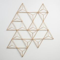 Handcrafted by Indian artisans, our three-dimensional geometric wall art makes a modern statement. Insert air plants to create a living art installation and combine multiple units to amplify the effect.