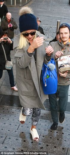 Please, no photos: Helen George appeared somewhat flustered by the whole experience...