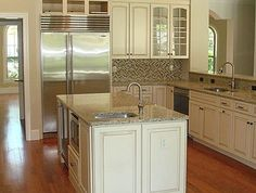 I like the lighter cabinets and glass lined cabinets with the walnut floors and stainless steel appliances but think I would do a darker countertop.