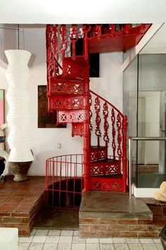 Yellow Spiral Stairs in the home of Shirly Kurata Pretty in Pink Red Spiral staircase Rainbow Staircase in an Ultra-modern hou. Interior Architecture, Interior And Exterior, Interior Design, Take The Stairs, Stair Steps, Painted Stairs, Stairway To Heaven, Stairways, My Dream Home