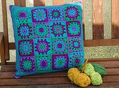 Love the colors in this granny square pillow cover