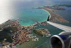 view from the window of a 757 climbing out of St Marten TNCM