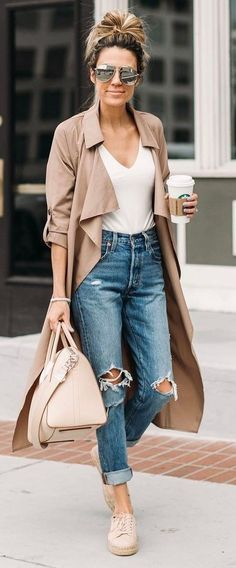 Blush trench coat, handbag and sneakers with white tee and distressed denim jeans.