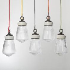 Hand blown prismatic glass pendant lights, Ceramic tops and cast iron hanging eye. Choice of cable colours.