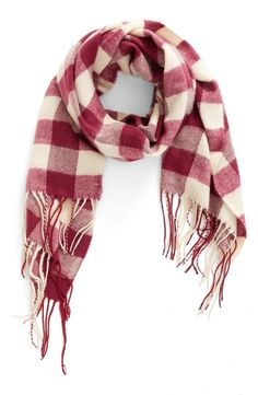Long, swingy fringe and on-trend Buffalo plaid lend unmistakable style to this supersoft and cozy scarf.