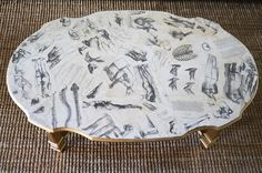 DIY Decoupaged Coffee Table - Kate Albrecht from Mr. Kate (she's featured on The Nate Berkus Show frequently) does the coolest makeover ever.  She starts with an old coffee table and an art book and it ends up being spectacular.  I'm going to start watching for art books at sales now.