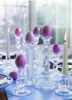 All that glitters... Create a striking arrangement with sparkling eggs and a collection of glass candlestick.  Spray dyed eggs with adhesive and roll them in iridescent glitter.  Use glass candlesticks at varying heights and add a few of them in with real candles.
