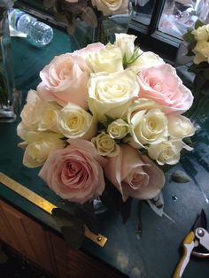 Bridesmaid bouquet of sweet avalanche, avalanche and spray rose with an edge of cinerea eucalyptus