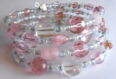 Sweet Sparkly Pink and Baby Blue with White Silver Oval Memory Wire Bracelet by VineDesignBeads. Visit me on Etsy!