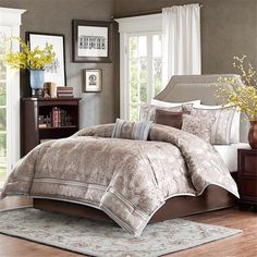 Chapman is a simple way to create an elevated look in your bedroom. A beautifully detailed gray damask print covers the comforter. The blue piping along the edges is an elegant detail that pulls the whole look together.  This comforter set also includes three embroidered decorative pillows in gray, brown, and blue and two king shams.